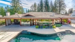 """With a sprawling patio, outdoor pool, lush gardens and epic home theatre, this 6,157-square-foot """"Palm Springs style"""" contemporary home might just be the ultimate entertainer's dream. On a quiet cul-de-sac backing onto the 12th Fairway of Capilano Golf Course, this estate includes five-bedrooms, a home gym, Tesla charging station – and is just a 15 minute drive from downtown Vancouver. Listed for $7.28-million, through Jason Soprovich (http://www.soprovich.com)."""