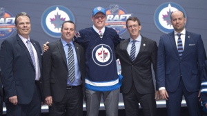 Patrik Laine, second overall pick, stands on stage with members of the Winnipeg Jets management team at the NHL draft in Buffalo, N.Y. on Friday June 24, 2016. (source: Canadian Press/Nathan Denette)