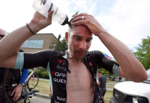 Bruno Langlois pours water on his head after winning the national champion title at the Canadian Road Championships cycling race, Sunday, June 26, 2016 in Ottawa. (THE CANADIAN PRESS/Justin Tang)