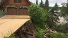 Heavy rains caused the slope beside Grant Fisette's home to collapse, sending rocks and earth down into the lake. (Source: Grant Fisette)