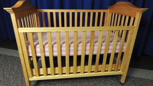 The federal government is banning the sale of drop-side cribs. Starting Dec. 29, it will be prohibited in Canada to sell, import, manufacture or advertise drop-side cribs. (AP Photo/Consumer Product Safety Commission )