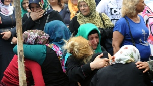 Family members of victims cry outside Bakirkoy State Hospital in Istanbul on Wednesday, June 29, 2016. (AP / Omer Kuscu)