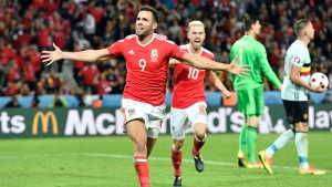 Wales' Hal Robson Kanu, left, celebrates after scoring his side's second goal during the Euro 2016 quarterfinal soccer match between Wales and Belgium, near Lille, France, on Friday, July 1, 2016. (AP Photo/Martin Meissner)
