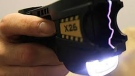 The student alleges an officer picked up an unsecured Taser from a table, commented it wasn't live' and pointed it at the woman. (File Image)