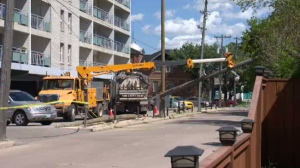 Manitoba Hydro crews work to restore power in Winnipeg on Thursday after this week's damaging storm.