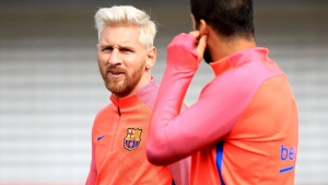Barcelona's star striker Lionel Messi, left, at St George's Park, Burton, England, on July 26, 2016. (Mike Egerton/PA via AP)