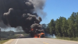 A witness captured raw video of a motorhome towing a car engulfed in flames down a northern Manitoba highway. (Source: Michael Cote/MyNews)