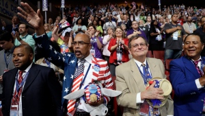 Louisiana delegates Bernie Woods, left, Rodney Mcfarland and Jim Harlan cheer after singing the national anthem during the third day session of the Democratic National Convention in Philadelphia, Wednesday, July 27, 2016. (AP Photo / Matt Rourke)