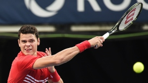Milos Raonic of Canada returns the ball against Yen-Hsun Lu of Taiwan during second round Rogers Cup tennis action in Toronto on Wednesday, July 27, 2016. (Nathan Denette / THE CANADIAN PRESS)