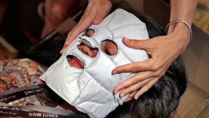 Jamie Palazzolo of Chaleur Beauty from Henderson, NV, applies one of their Self-Heating Facial Masks at the annual International SPA Association event, in New York on July 27, 2016. (AP /Richard Drew)