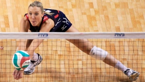 In this Jan. 9, 2016, file photo, United States' Jordan Larson-Burbach plays a shot during a women's volleyball NORCECA round-robin Olympic qualifying tournament match against the Dominican Republic in Lincoln, Neb. Larson-Burbach been named to the U.S. women's volleyball roster for the upcoming Rio Olympics by coach Karch Kiraly. (AP Photo/Nati Harnik, File)