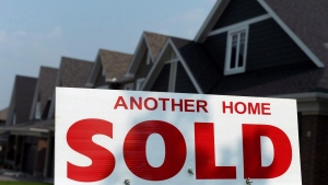 A for sale sign displays a sold home in a development, in Ottawa, on July 6, 2015. (THE CANADIAN PRESS/Sean Kilpatrick)