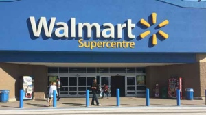 Walmart announced in June that it would expand its phase-out of Visa at all of its Canadian stores. (File)
