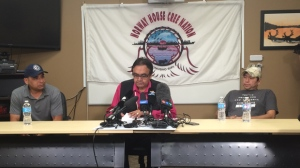 Leon Swanson (left) and David Tate (right) from Norway House Cree Nation flank former Manitoba Aboriginal Affairs Minister Eric Robinson (centre) at a news conference on Friday. Swanson and Tait were switched at birth. (Photo: Cheryl Holmes/CTV Winnipeg)