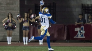 Winnipeg Blue Bombers defensive back Maurice Leggett celebrates as he crosses the line for a touchdown following a pass interception on Montreal Alouettes quarterback Kevin Glenn during second quarter CFL football action Friday, August 26, 2016 in Montreal. THE CANADIAN PRESS/Paul Chiasson