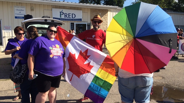 People gather in Portage la Prairie Saturday for the first-ever Portage Pride March. (Photo: Beth Macdonell/CTV Winnipeg)