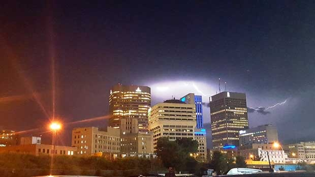 Lightning caught in Downtown Winnipeg. Photo by Ariel Mogan.