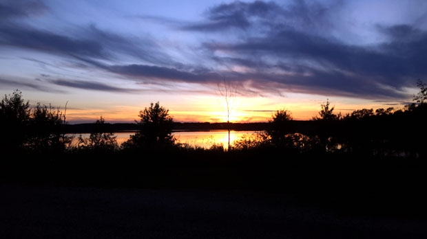 A serene scene captured at Patterson Lake, MB