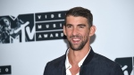 Michael Phelps poses in the press room at the MTV Video Music Awards at Madison Square Garden on Sunday, Aug. 28, 2016, in New York. (Evan Agostini/AP)