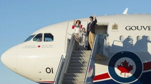 Canadian Prime Minister Justin Trudeau, his wife Sophie Gregoire, and daughter Ella-Grace wave as they board a government plane in Ottawa, Monday August 29, 2016. (Source: Adrian Wyld/The Canadian Press)
