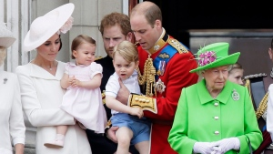 Britain's Queen Elizabeth II, right, with Prince William holding Prince George, centre, and Kate, Duchess of Cambridge holding Princess Charlotte, left, on the balcony during the Trooping The Colour parade at Buckingham Palace, in London, Saturday, June 11, 2016. (AP Photo/Tim Ireland)