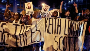 Protesters shout as they march in the streets of Charlotte, N.C, to protest Tuesday's fatal police shooting of Keith Lamont Scott on Friday, Sept. 23, 2016. (AP / Chuck Burton)