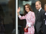 The Duke and Duchess of Cambridge are escorted down to Harbour Air Terminal in Victoria, B.C., Sunday, Sept 25, 2016 where they departed on a float plane on their way to Vancouver for planned events. (Chad Hipolito / THE CANADIAN PRESS)