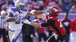 Winnipeg Blue Bombers' Kevin Fogg, left, breaks free from Calgary Stampeders' Adam Berger during second half CFL football action, in Calgary on Saturday, Sept. 24, 2016. (The Canadian Press/Larry MacDougal)