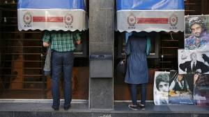 Iranians use ATM machines of Bank Melli Iran in downtown Tehran, Iran, on April 4, 2015. (Vahid Salemi / AP)