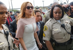 In this file photo dated Monday, March 18, 2013, actress Lindsay Lohan arrives at the Los Angeles Superior court. (AP Photo/Damian Dovarganes, FILE)
