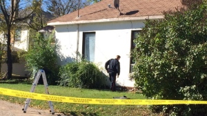 On Monday morning police were still on scene at the home on Lorne Avenue East. (Josh Crabb/CTV Winnipeg)