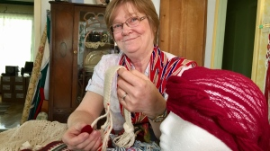 Carol James has become an internationally recognized expert in finger weaving, with a particular expertise in ancient textiles. (Jon Hendricks/CTV Winnipeg)