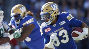Winnipeg Blue Bombers' Andrew Harris (33) runs against the Saskatchewan Roughriders during first half CFL Banjo Bowl action, in Winnipeg on September 10, 2016. (Photo: John Woods/The Canadian Press)