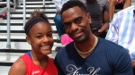 Trinity Gay with her father Tyson Gay in Georgetown, Ky., on  May 3, 2014. (Mark Maloney / Lexington Herald-Leader via AP)