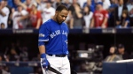 Toronto Blue Jays first baseman Edwin Encarnacion (10) reacts after striking out against the Cleveland Indians during ninth inning, game five American League Championship Series baseball action in Toronto on Wednesday, October 19, 2016. (Nathan Denette/The Canadian Press)