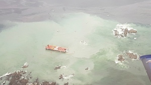 A tug boat that ran aground near British Columbia's Great Bear Rainforest is seen in this aerial handout photo on Thursday, Oct. 13, 2016. (Western Canada Marine Response Corp.)