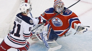 Edmonton Oilers goaltender Cam Talbot (33) saves the shot from Winnipeg Jets' Kyle Connor (81) during second period NHL Heritage Classic action in Winnipeg on Sunday, October 23, 2016. (The Canadian Press/John Woods)