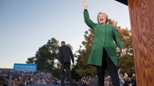 Democratic presidential candidate Hillary Clinton waves at the audience as she arrives at a campaign event at University of North Carolina at Charlotte, Sunday, Oct. 23, 2016, in Charlotte, N.C. (AP Photo/Mary Altaffer)