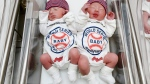 Unidentified babies wear World Series onesies at the Cleveland Clinic's Fairview Hospital in Cleveland on Tuesday, Oct. 25, 2016.  (Cleveland Clinic via THE ASSOCIATED PRESS)
