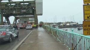Emergency crews on the scene where a car plunged into Lake Ontario after hitting a guardrail near Cherry Street.