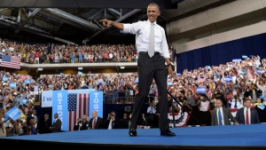 President Barack Obama arrives to speak during a campaign event for Democratic presidential candidate Hillary Clinton at the CFE Federal Credit Union Arena in Orlando, Fla., Friday, Oct. 28, 2016. (AP Photo / Susan Walsh)