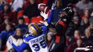 Winnipeg Blue Bombers' Terrence Frederick blocks a pass on Ottawa Redblacks' Jamill Smith during second half of CFL action in Ottawa on Friday, Nov. 4, 2016. THE CANADIAN PRESS/Sean Kilpatrick