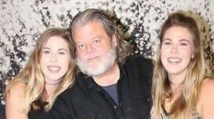 David MacDonald with twin daughters, Allison (left) and Brianna (right). Both girls live in Nelson House. (Source: Alexandria Moodie)