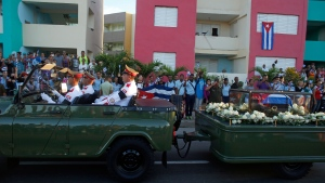 "The motorcade carrying the ashes of the late Cuban leader Fidel Castro makes i's final journey towards the Santa Ifigenia cemetery in Santiago, Cuba Sunday, Dec. 4, 2016. Thousands of people lined the short route from the Plaza Antonio Maceo or Plaza of the Revolution to the cemetery waving Cuban flags and shouting ""I am Fidel!"".(AP Photo/Dario Lopez-Mills)"