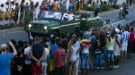 The motorcade carrying the ashes of the late Cuban leader Fidel Castro makes i's final journey towards the Santa Ifigenia cemetery in Santiago, Cuba Sunday, Dec. 4, 2016. (AP Photo/Ricardo Mazalan)