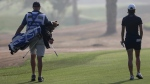 Caddie Maximilian Zechmann works during the 1st round of Dubai Ladies Masters golf tournament in Dubai, United Arab Emirates, on Dec. 7, 2016. (Kamran Jebreili / AP)