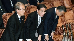 Japanese Economic Revitalization Minister Nobuteru Ishihara, Foreign Minister Fumio Kishida and Agriculture Minister Yuji Yamamoto, from left, bow after the Trans-Pacific Partnership (TPP) was approved in Tokyo Friday, Dec. 9, 2016. (Yoshinobu Shimizu/Kyodo News via AP)