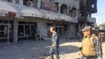 FILE -- In this Oct, 22, 2016 file photo, Iraqi security forces inspect one of the damaged buildings after deadly clashes between Iraqi security forces and members of the Islamic state in the city of Kirkuk, 180 miles (290 kilometers) north of Baghdad, Iraq.(AP Photo, File)