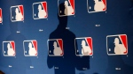 The shadow of MLB Commissioner Rob Manfred on an MLB logo backdrop in Phoenix, on Feb. 23, 2015. (Ross D. Franklin / AP)