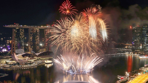 Fireworks explode above Singapore's financial district at the stroke of midnight to mark the New Year's celebrations on Sunday, Jan. 1, 2017, in Singapore. (AP Photo/Wong Maye-E)